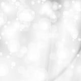 Abstrakcjonistyczni biali błyszczący światła, srebny tło Obrazy Stock