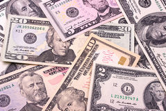 Abstrakcjonistyczni dolarowi rachunki różny wyznania tło Fotografia Stock