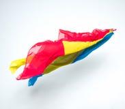 Abstrakcjonistyczni kolorowi kawałki tkaniny latanie Obrazy Royalty Free