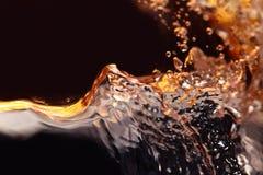 Abstrakcjonistyczni pluśnięcia biały wino na czarnym tle Fotografia Stock