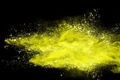Abstrakcjonistyczny żółty pyłu wybuch na czarnym tle fotografia royalty free