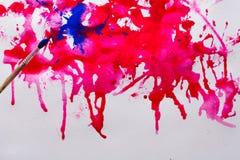 Abstrakcjonistyczny akwareli farby pluśnięcie na papierowej teksturze ilustracji