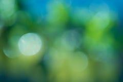 Abstrakcjonistyczny błękitny i zielony kółkowy bokeh tło Zdjęcia Stock