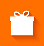 Abstrakcjonistyczny boże narodzenie prezenta pudełko na pomarańczowym tle Fotografia Royalty Free