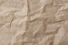 Abstrakcjonistyczny brąz przetwarza zmiętego papier dla tła papierowy tekstury tło Obrazy Stock