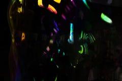 Abstrakcjonistyczny czarny tło z kolorów kleksami Obrazy Stock