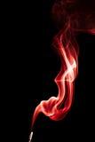Abstrakcjonistyczny czerwień dym na czarnym tle Fotografia Royalty Free