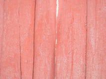 Abstrakcjonistyczny czerwony drewniany lampasa tło Obrazy Royalty Free