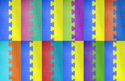 Abstrakcjonistyczny kolorowy łamigłówki tło. Zdjęcie Royalty Free