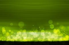 Abstrakcjonistyczny kolorowy bokeh na zielonym tle Obrazy Stock