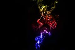 Abstrakcjonistyczny kolorowy dym na czarnym tle Zdjęcie Stock