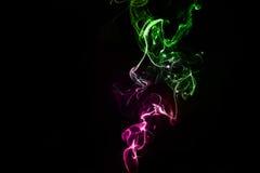 Abstrakcjonistyczny kolorowy dym na czarnym tle Obraz Royalty Free