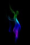 Abstrakcjonistyczny kolorowy dym odizolowywający na czarnym tle. Fotografia Stock