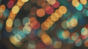 Abstrakcjonistyczny kolorowy rozmyty poruszający Bokeh dekoruje światło carousel przejażdżka w rozrywce zdjęcie wideo