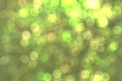 Abstrakcjonistyczny kurendy zieleni bokeh tło Zdjęcia Royalty Free