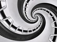 Abstrakcjonistyczny nowożytny samochodowego koła obręcz z oponą przekręcał w surrealistyczną spiralę Samochodu tła powtórkowa des obraz stock