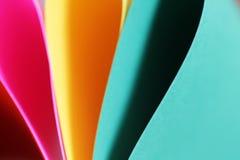 Abstrakcjonistyczny papierowej sterty defocused colourful tło Fotografia Stock