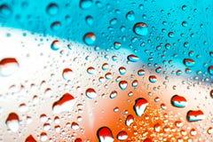 Abstrakcjonistyczny pomarańczowy tło z wodnymi kroplami Zdjęcie Royalty Free