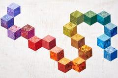 Abstrakcjonistyczny projekt kolorowe kawałek tkaniny które patrzeją jak sześciany Zdjęcia Stock