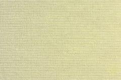 Abstrakcjonistyczny pusty tło dla układów Gęsty żółty tapicerowanie tkaniny zbliżenie zdjęcia stock