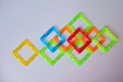 Abstrakcjonistyczny skład z colourful kwadratami na jasnopopielatym tle Fotografia Stock