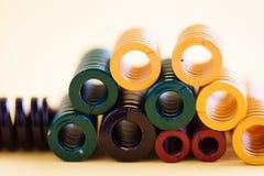 Abstrakcjonistyczny stali spirali zwitki wiosen kolekci set Różnego twardości elastyczności rozmiaru kolorowi przedmioty Płytka g Obraz Stock