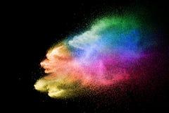 Abstrakcjonistyczny stubarwny prochowy wybuch na czarnym tle Koloru pyłu cząsteczka splattered na tle obraz royalty free