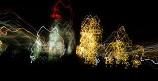 Abstrakcjonistyczny tło żarówki przy nocą w ruchu Zdjęcia Stock