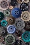 Abstrakcjonistyczny tło guziki różni rozmiary obrazy stock