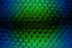 Abstrakcjonistyczny tło od plastikowego opakowania z błękitnym, czarny, kolor żółty Fotografia Royalty Free