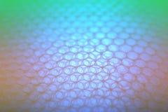 Abstrakcjonistyczny tło od plastikowego opakowania z kolorowym światłem Obraz Stock