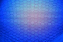 Abstrakcjonistyczny tło od plastikowego opakowania z zmrokiem - błękit, czerwień Fotografia Stock