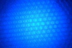 Abstrakcjonistyczny tło od plastikowego opakowania z zmrokiem - błękit i whit Obrazy Royalty Free