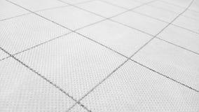 Abstrakcjonistyczny tło textured materialna powierzchnia od geometryczni deseniowi wielcy quadrates i cienieje linie jako szablon fotografia stock