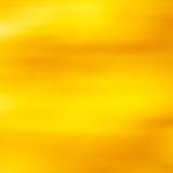Abstrakcjonistyczny tło w żółtym złocie Zdjęcia Stock