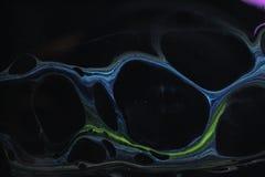 Abstrakcjonistyczny tło w czarnych prawdziwych wielkich błękitnych i zielonych komórkach fotografia stock