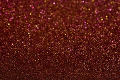 Abstrakcjonistyczny tło wypełniający z błyszczącą czerwienią i bonza połyskujemy zdjęcia stock