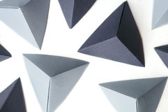 Abstrakcjonistyczny tło z kopia astronautycznymi i monochromatycznymi origami czworościanami Obrazy Royalty Free