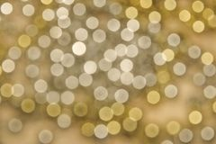 Abstrakcjonistyczny tło z wiele złotymi bokeh cyklami zdjęcie royalty free