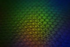 Abstrakcjonistyczny tło od plastikowego opakowania z kolorowym ciemnym lig Obrazy Royalty Free