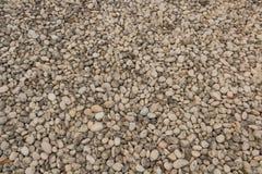 Abstrakcjonistyczny tło z suchymi round reeble kamieniami Zdjęcia Stock