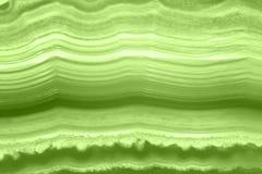 Abstrakcjonistyczny tło - zielonego agata plasterka PANTONE kopalny makro- greenery Obraz Royalty Free
