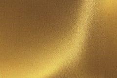 Abstrakcjonistyczny tekstury tło, błyszczących narysów metalu złota foliowa ściana zdjęcie stock