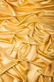 Abstrakcjonistyczny tło, draperii złota tkanina. Obraz Royalty Free