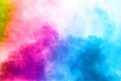 Abstrakcjonistyczny wielo- koloru proszka wybuch na białym tle fotografia royalty free