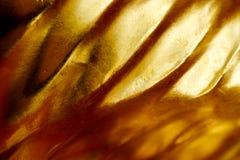 Abstrakcjonistyczny złocisty tło, glansowany metal obraz royalty free