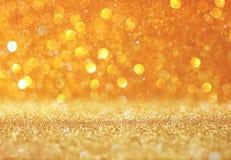 Abstrakcjonistyczny złocisty tło z kopii przestrzenią gliiter bokeh światła Fotografia Royalty Free