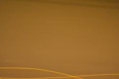 abstrakcyjny tło Linie i krzywy w brązie i pomarańcze Fotografia Stock