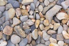 Abstraktów wzory i kształty: Kamienni otoczaki na plaży: Portret O fotografia stock