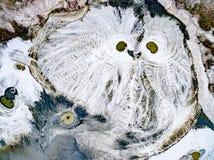 Abstraktów wzory na ziemi od wody leją się przypominający sowy Zdjęcia Royalty Free